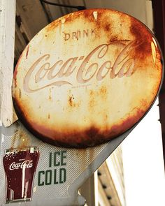 "Coca-Cola  Seeing an old Coca-Cola sign like this one at the Hob Nob Restaurant in Nashville, Indiana transports me back to my childhood in the 1950's. Signs like this were everywhere -- a ""Coke"" cost a nickel and came in that classic 6 1/2 ounce bottle. If you went to the local ""drugstore"", also known as ""Hefty's"", you could get Cherry Cokes, Chocolate Cokes, and Vanilla Cokes in a glass the shape of the one shown on the sign above, AND you had to have some peanut butter crackers to go with…"