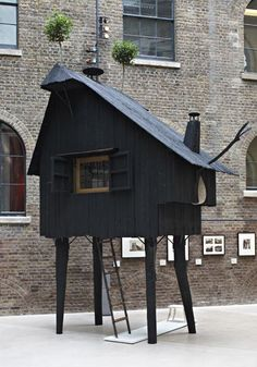 So up our alley- a perfect playhouse for h&z! Maybe I'd add just a slash of color and vintage charm and it would be just right!