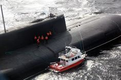 """The Oscar-class cruise-missile submarine """"Voronezh,"""" came to the rescue after they had sent out a distress signal. Russian Nuclear Submarine, American Aircraft Carriers, Tiny Boat, Utility Boat, Wood Boat Plans, Sailboat Plans, Cruise Missile, Cabin Cruiser, Yellow Submarine"""