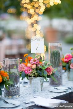 The pops of color from the floral really bring out the table! Adding in the ivory vintage lace runner adds to the rustic centerpieces for this destination wedding.