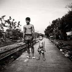 One of my absolute favorite images. A father and son in Muay Thai shorts. Following in his fathers footsteps, the present and future of Muay Thai.Muay Thai, Thai Boxing, Thailand, Tours, Entertainment, Sport. Details about Muay Thai in Koh Samui are available here; http://www.islandinfokohsamui.com