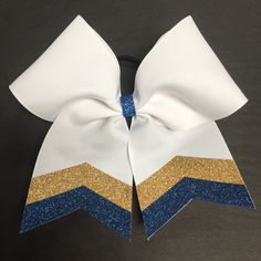 Uniquely themed, affordable, high quality cheer bows. Hand crafted locally in North Carolina and made with the finest ribbon to ensure that the bows are durable and sturdy. Hair ties are carefully che