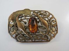 Victorian Sash Pin With Lion With 2 Crocodiles & Amber Color Glass