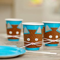 Cat Party Cups: Trim inner and outer ears from craft paper. Assemble and glue ears to top of cup jacket, about 1/2 inch apart. Cut eyes from craft paper and draw on pupils, then glue eyes an inch apart under the ears. Cut 4 inch strips of paper, about 1/8 inch wide, to glue under nose as whiskers. Cut a nose out of pink felt and stick to center of whiskers.