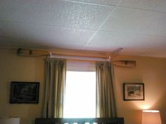 My sister used two oars as curtain rods at her lake house