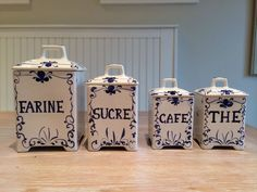 Set Of Four (4) White Ceramic Kitchen Canisters With French Labels