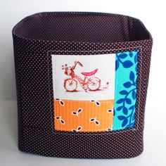 Fabric bin tutorial by Lisa Truesdell via http://www2.fiskars.com/Activities/Crafting/Project-Gallery/Sewing-and-Quilting/Multipurpose-Fabric-Bin