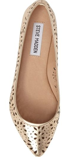 Perforated petals play about the smooth surface of this elegantly simple flat with a delicate pointed toe.