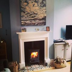 Lounge: wood burner, painted mantelpiece and tiled hearth // fireplace hearth tile ideas Wood Burner Fireplace, Tall Fireplace, Fireplace Bookshelves, Limestone Fireplace, Fireplace Hearth, Home Fireplace, Fireplace Remodel, Fireplace Surrounds, Fireplace Design