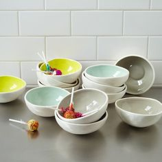 "From West Elm $5 each.  Color contrast. The insides of these ceramic Colored Glaze Prep Bowls are hand painted in different hues. Perfect for portioning out ingredients, they're also great for serving small bites or catching clutter on bookshelves, dressers and desks.    Glazed earthenware.  4.9""diam x 2""h.  Color is hand-applied.  Hand wash.  Imported."