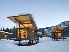 Rolling Huts hotel consists of a so-called 'herd' of six tiny huts, decorated with modular furniture and a sleeping platform. The bathroom and showers are in a separate hut.  Tim Bies / Olson Kundig Architects