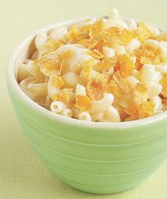 Bowl of mac-and-cheese with corn flakes.  For a new twist on a serial dinner favorite, add a layer of crunch to plain old mac-and-cheese.  Top your child's bowl with a sprinkling of flakes (even the bits at the bottom of the bag work).  It's easier and more kid-friendly than toasted bread crumbs.