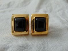 vintage escada gold plated black glass clip on earrings signed by qualityvintagejewels on Etsy Gold Jhumka Earrings, Jewelry Design Earrings, Gold Earrings Designs, Gold Jewellery Design, Ear Jewelry, Coral Earrings, Gold Ring Designs, Gold Jewelry Simple, Engagement Jewellery