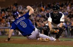 San Francisco Giants catcher Andrew Susac, right, puts the tag on Colorado Rockies' D.J. LaMahieu as he tries to score from second base on Charlie Blackmon's single in the seventh inning of a Major League Baseball game at AT&T Park in San Francisco, Monday, Aug. 25, 2014. LaMahieu was initially ruled safe on the play, but the call was overturned on a replay challenge. (D. Ross Cameron/Bay Area News Group)