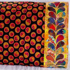 Westminster Fabrics Fabric Used: Kaffee Fassett Prints Collection for Rowan Download the free feather applique pattern here:  http://www.allpeoplequilt.com/millionpillowcases/freepatterns/Pillowcase-37.pdf