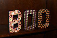 Cardboard letters + Cardstock + Modge Podge = cute holiday shelf decoration
