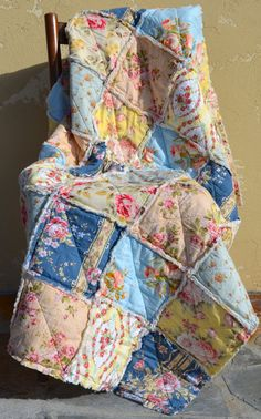 Shabby Chic Rag Quilt, French Floral, blue, green, yellow, peach, & pink with ivory colored backing.