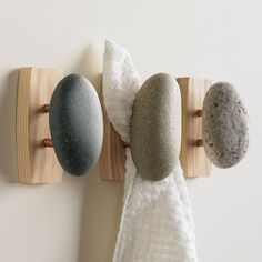 What a totally cool idea to use river rocks as towel hooks. I have used robe hooks as towels holders, but these are so much cooler. Especially if you are using river stones anywhere in you bath, ie shower walls or floors. They'd also be nice outside by a pool, or new a hose for children during the summer when water ballon fights, err tosses are waiting.