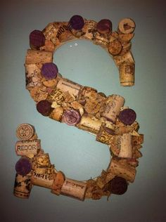 Love these cork letters!    http://blogs.babble.com/the-new-home-ec/2011/12/22/15-amazingly-useful-ways-to-reuse-wine-corks/?pid=9316#slideshow