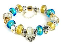 """""""Mother Daughter"""" Murano Charm Bracelet with 20 Gorgeous Beads and Charms Including Mother & Daughter Dangle Bead, Gold and Turquoise Murano Beads: High-quality Pandora Style Complete Bracelet Opens so Beads CAN Be Changed Beautiful Silver Jewelry. $79.95. Fabulous Gold Foil, Turquoise with Gold Flake and White Flower Bubble Murano Beads. Arrives Ready To Give in Pink Gift Box With Bow. Pandora Compatible Bracelet. Bracelet End Unscrews So Beads CAN Be Changed. Saf..."""