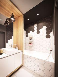 carrelage hexagonal en noir et blanc comme accent remarquable dans la salle de bains