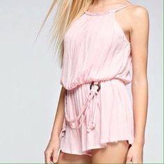 """Tea n Cup """"Pretty In Pink"""" Romper Spaghetti strap romper with synched waistline and rope belt. 100% Cotton. Model wearing size SMALL. Junior size fit. I suggest to go up one size.  Covershot, 2nd, 3rd, & 4th images from @teancup   (This listing is ready to purchase """"as is"""" please use the """"BUY NOW"""" or """"ADD TO BUNDLE"""" feature to purchase) Bundle for bigger discounts! Price Firm unless bundled. Tea n Cup Pants Jumpsuits & Rompers"""