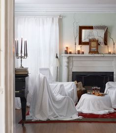 Easy Halloween Decoration  These decorating tricks are so easy, it's frightening. Use sheet-draped chairs to give your room the look of ruin.