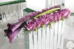 """These mirrored vases and the """"Fresh Touch"""" florals can be purchased from couturehomeaz.com"""