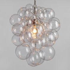 Bubble Glass Orb Chandelier-This chandelier is like a little cluster of bubbles in the sky from Dreamy chandelier, glass chandelier, bubble chandelier Chandelier Design, Bubble Chandelier, Pendant Chandelier, Chandelier Lighting, Empire Chandelier, Modern Chandelier, Chandeliers, Decoration For Ganpati, Glass Globe