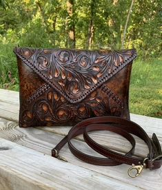 Christmas Hand-Tooled Leather Crossbody & Clutch Bag | Etsy Tooled Leather Purse, Leather Tooling, Leather Handbags, Leather Purses, Leather Crossbody, Crossbody Clutch, Satchel, Orange Leather, Natural Leather