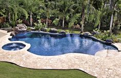 Free-Form Pools | Blue Haven Pools-nice gray coping and blue water contrast. Brown deck.
