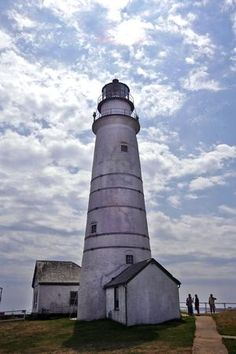 Clouds above Little Brewster Island, home to Boston Light, the nation's first lighthouse. Quincy, MA - The Patriot Ledger