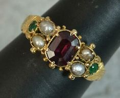 Size M UK, 6 US. No marks, tests as Modelled in 15 carat gold. x cluster head. Very good overall condition. Resizing mark to inside of shank. Garnet Rings, Gold Platinum, Carat Gold, Gold Pearl, Cluster Ring, Shank, Emerald, Gold Rings