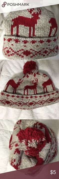 American Eagle Outfitters Reindeer Knit Hat w/Ball Wool blend AE knit hat with festive reindeer pattern. One Size fits all men or larger women's heads. Bought for myself not realizing it was men's and it's too big. American Eagle Outfitters Accessories Hats