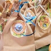 brown/kraft paper gift bags with green ribbon/twine?  or just their fairy houses (or pack them in the bags??)