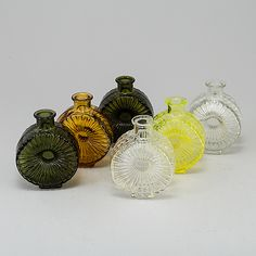 "A set of six glass bottles ""Solflaska"" by Helena Tynell, Riihimäen Lasi Oy. Glass Design, Design Art, Genie Bottle, Bukowski, Glass Bottles, Finland, Modern Contemporary, Retro Fashion, Glass Art"