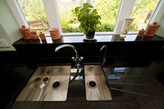 Black Galaxy Granite worktops, twin undermounted sinks, windowsill
