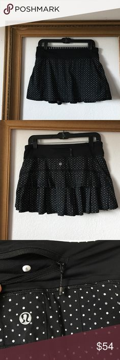 Lululemon black polka dot active tennis skirt, 6 In great condition, no signs of wear, however the ball pocket has been altered to open from the top as seen in photo above. Equipped with drawstring, two front key pockets, back zippered pocket, sticky leg bands, and altered ball pocket on left leg. lululemon athletica Skirts Mini