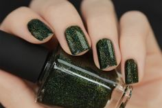 Ski Lodge is a deep and dark mossy green holographic nail polish that's truly unique!   The wondrously organic forest green shade of Ski Lodge, coupled with a precise blend of holographic pigments and gold micro-flakes come together perfectly to create a seriously beautiful nail polish just perfect for the season.  The jaw-dropping depth of Ski Lodge will put a smile on your face after the first coat. You have to see this stunner person!  Fully opaque in 2 to 3 coats!