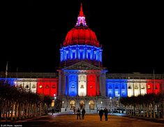 San Francisco City Hall is covered in the colors of the French flag in solidarity with the people who lost their lives in France