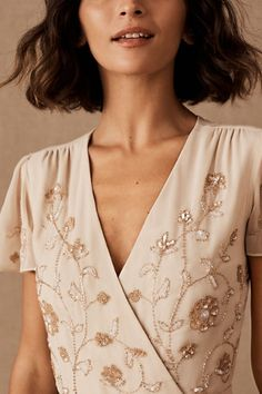 Gold beading is a stunning complement to dusky blush on this effortlessly glam wrap dress with flutter sleeves. Only available at BHLDN Bhldn, Groom Dress, Body Measurements, Flutter Sleeve, Bra Sizes, Plymouth, Wrap Dress, Stylists, Take That