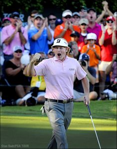 """""""Brandt Snedeker celebrates on the 18th green after his three-stroke victory during the final round of the TOUR Championship by Coca-Cola. It's always a challenge to shoot at the 18th green at East Lake, so I situated myself in one of the corporate chalets and hoped he would turn my way for the win shot. He did, and my motorized sequence captured his jubilation with the crowd in the background celebrating as well."""" -- Stan Badz, PGA TOUR Photographer"""