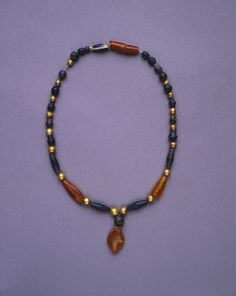 Jewelry from The Royal Tombs of Ur Necklace of gold, lapis, and carnelian.