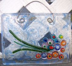 Bouquet of flowers suncatcher by CrazyEyeFusedGlass on Etsy, $25.00