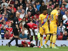 Eric Bailly of Manchester United lies injured during the Premier League match between Manchester United and Crystal Palace at Old Trafford on May 21...