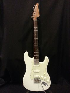 Suhr Classic Antique Olympic White w Roasted Maple Neck.
