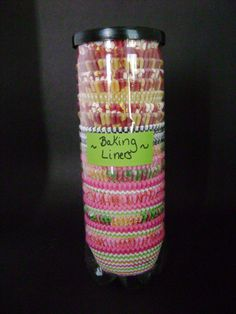 Using a tennis ball container to store cupcake liners!