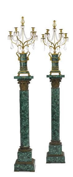 A pair of Russian neoclassical cut glass-mounted ormolu and malachite four-light candelabra 19th century on later gilt bronze and malachite pedestals.  height 32 in. 81.5 cm