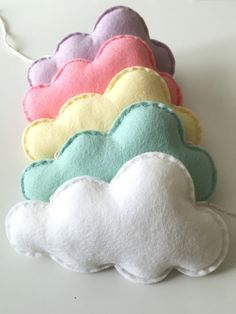 Cloud Felt Garland, Cloud Bunting, Cloud Theme Nursery, Girls Nursery Decoration, Wall Decoration, Nursery Bunting, Pastel Nursery, Cloud Decoration A pretty mix of pastel coloured clouds which would be a lovely decoration for a little girls nursery/bedroom. This item is made to order. Please see shop announcement for current turnaround time. This design compliments my cot & wall mobiles beautifully. All sewn by hand, the clouds come in 4 gorgeous shades of pastel colours and 1 white one...