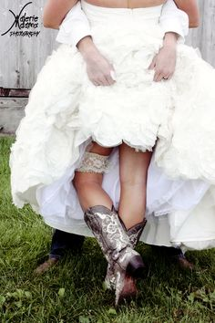 showing off garter and country boots - scandalous bride and groom picture